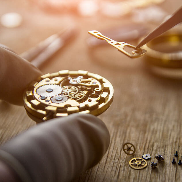 Master jeweler repairing a pocket watch | Jewelry Repair