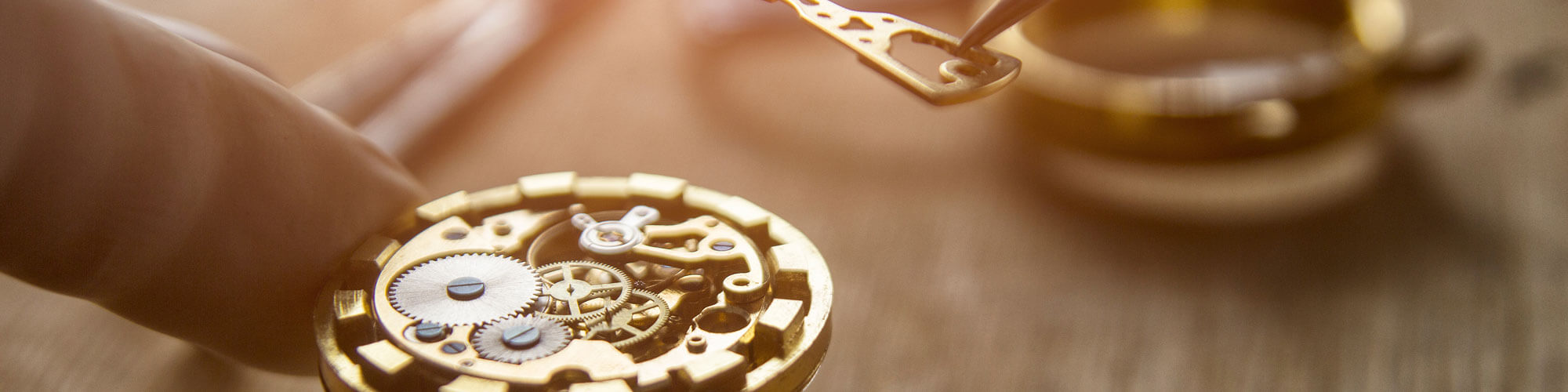 Close up of a pocket watch being repaired by a professional jeweler